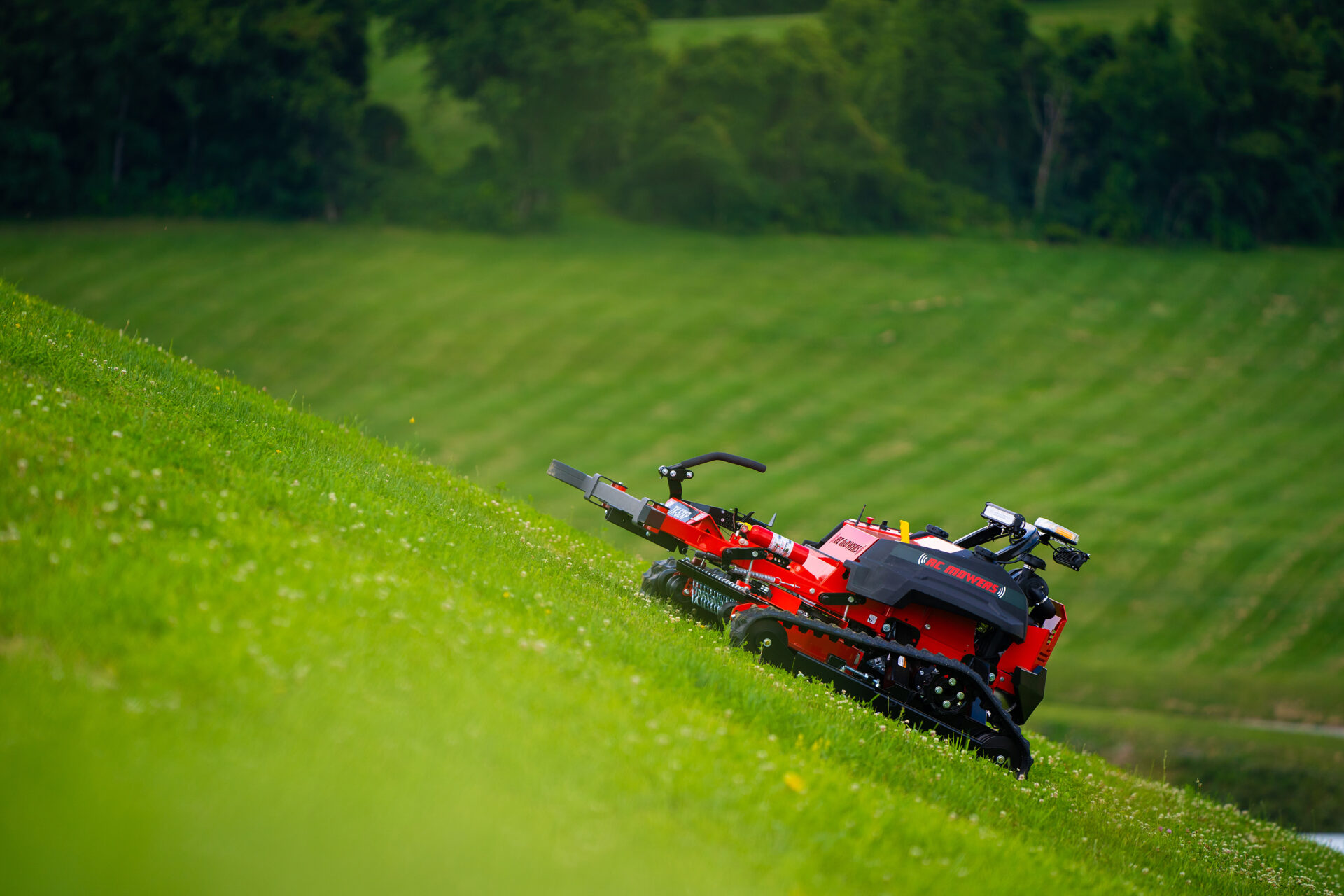 Steep slope mowers